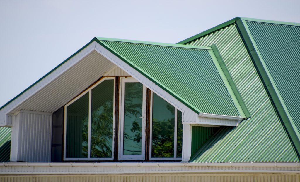 Green corrugated metal roofing on residential roof