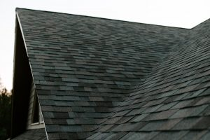 Malarkey Highlander NEX Architectural Shingles in Natural Wood on Residential Roof Side Gable
